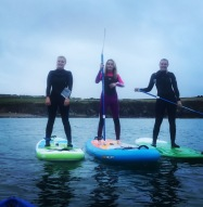 Jemeima and friends SUP off Porthsele beach