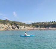 Olivia kayaking off Porthsele