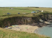 Porthsele beach with camping fields above